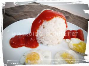 Risotto con huevos de codorniz y tomate
